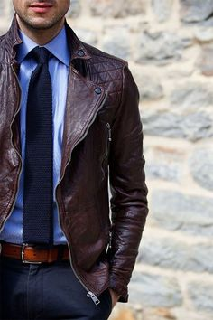 Shop this look for $233:  http://lookastic.com/men/looks/biker-jacket-and-dress-shirt-and-tie-and-belt-and-dress-pants/2252  — Dark Brown Leather Biker Jacket  — Light Blue Dress Shirt  — Navy Knit Tie  — Tobacco Leather Belt  — Navy Dress Pants