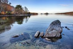 Tilted sinking ship-like rocks along Quabbin Reservoir shoreline, MA