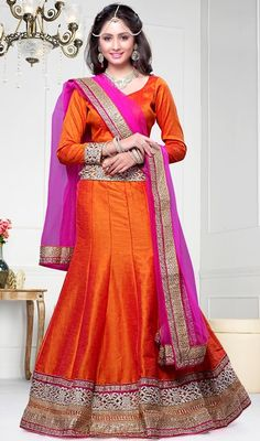 Reveal the exuberance in you with this orange shade raw silk lehenga cholie. The lace and resham work appears chic and ideally suited for any get together. Upon request we can make round front/back neck and short 6 inches sleeves regular lehenga blouse also. #DhupionShadesOfFishCutLehengaCholi