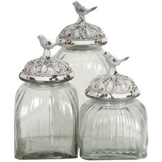 Set of three glass jars with antiqued lids and bird finials.Product: Small, medium and large jar   Construction Material: ...