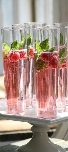 champagne, cranberry juice + raspberries