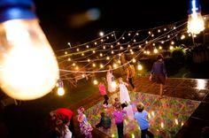 Great Idea for a wedding reception dance floor. Use old school light bulbs over the dance floor, adds a romantic glow. Fallbrook Photography