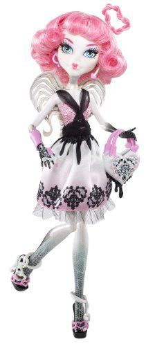 Monster High Sweet 1600 C.A. Cupid Doll, wears a pink, white and black strapless dress. The top is pink and halfway covered by a black waist band, to which a black lace shawl is attached that rests around C.A.'s arms. The skirt sections starts off with black marking that makes it look like it's flowing from the waist band. Below that the skirt is white, which gradually changes to pink towards the bottom.
