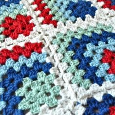 Learn how to make this beautiful mitered granny square blanket - perfect for a baby boy!