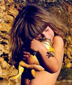 "Tippi Degre, ""a real life Mowgli"", hugging a bullfrog. Tippi was born and raised in the wild until the age of 10. She befriended all sorts of wild animals, forming very close bonds with them from an early age. Even animals otherwise considered to be extremely dangerous accepted her and included her as one of their own."