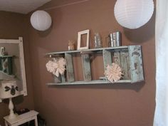 ladder, burlap wreaths, metal, jar, white frame. hung with branches from yard.