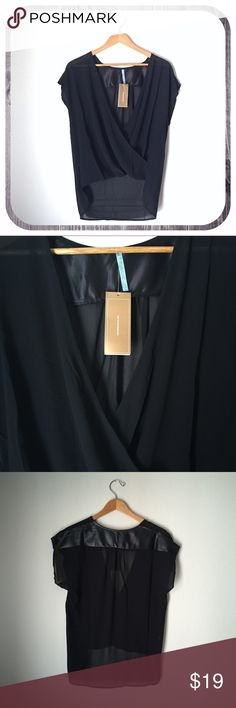 Moonlight, Drapey Sheer V-Neck, Black Wrap style forms deep v-neck in front. Short dolman style sleeves. Faux leather panel on upper back continues up the shoulders. Sheer fabric. Length of back about four inches longer than front. Never worn, new with tags. Moonlight Tops Blouses