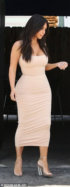 Stepping out! The brunette beauty teamed her nude dress with a pair of strappy clear heels