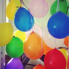 Wake up to a curtain of balloons in her bedroom's door