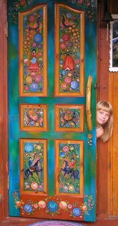 Russian wooden house. Entrance door decorated with folk Gorodets painting from Russia. #Russian #wooden #house                                                                                                                                                      More