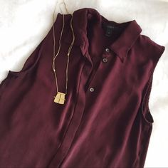 J. Crew Sleeveless Button Down Beautiful maroon colored sleeveless button down by JCrew! Super soft silk and amazing color. Only worn once, like new. Open to reasonable offers! J. Crew Tops Button Down Shirts