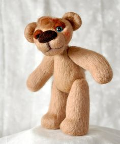 "Piere is a lovely needle felted wool teddy bear, 14 cm (5.5"") tall when sits, and a whole 20.5 cm (8"") tall when stands. Glass bead safety eyes.  Loosely five way jointed with locknut joints."