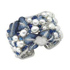 Inspired by Australia's blue Vanda orchid, the Vanda cuff from Autore jewellery features 44 large Keshi pearls, 7,000 diamonds, and both rough and facetted sapphires