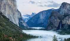 Yosemite valley covered in fog just after dusk © Doug Vaughn / 500px