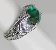 """An enchanting 8 carat Russian formula Emerald cubic zirconia is the crowning beauty for this extraordinary antique-style """"Phantom of the Opera"""" creation. It is completely surrounded by 18 round Cubic Zirconia Diamonds and the ring itself is like a work of art. A real must see. Ring is rhodium plated for a lifetime of enjoyment and beauty.$25.94 #Teamsellit"""