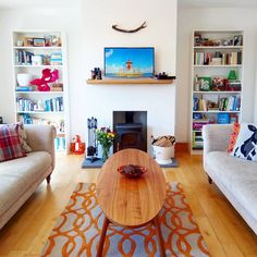 A very Wes Anderson living room full of symmetry and earthy tones Chesterfield Style Sofa, Wes Anderson, My Living Room, Earthy, Sofas, Bookcase, Shelves, Interior Design, Inspiration