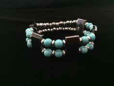 Women's Stretch Turquoise & Hematite Bracelet by PrettyBeadsOnaString on Etsy https://www.etsy.com/listing/272171988/womens-stretch-turquoise-hematite