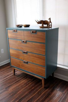 Painting a mid-century piece usually makes me cringe, but this dresser is beautiful – Re-furbished/painted Mid-Century Dresser Blue $650 , by Revitalized Artistry.
