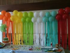 The balloon and streamers made an awesome backdrop for a dr seuss baby shower.