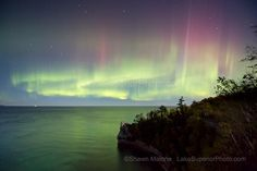 aurora borealis northern lights in the upper peninsula of michigan at miners castles pictured rocks national lakeshore