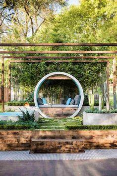 aménagement jardin extérieur -moderne-banc-bois-moderne-pergola-bois-parterres-ronds-beton