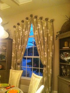 """4"""" medium hammered and contemporary drapery medallions used in an arched window treatment.  Decorative drapery hardware provided by Metropolis Iron, Inc."""