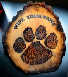 Wipe your Paws home decoration by WoodburnedDoodles on Etsy, $25.00