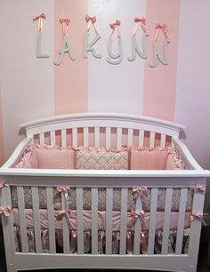 This nursery is AMAZING. The whole room is this theme/color and the material from the bedding is used for the curtain and decorations around the room!