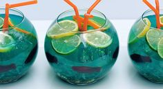 """You can use this idea to make a fun NON-alcoholic drink!  Try blue Cool Aid and Swedish fish with """"nerds"""" in the bottom for colored rocks.  Cute!"""
