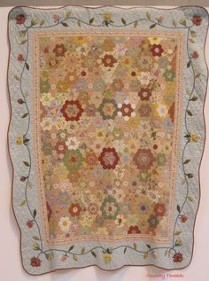 Traditional Quilts There were a surprising number of quilts using the hexagon shape this year. Some of the quilts looked quite old (I reco...