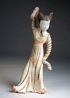 Dancing female tomb figure. Tang Dynasty, ca. 7th–9th century. Earthenware and pigment. In the Perlman Teaching Museum.