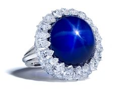 Star Sapphire set in a perfectly calibrated mound of pear shapes. THIS takes my breath away.