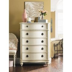 The shabby chic appeal of Emmas Treasures 5 Drawer Chest makes it perfect for the bedroom of girls at any age. With five solid wood drawers there is plenty of storage for all of her things. The drawers feature center mounted metal on metal drawer guides with built-in drawer stops. Elegant hardware in an antique pewter finish provides a nice contrast against the vintage white finish. This chest is full of beautiful details from the curved drawer really-cool-kids-and-toddler-beds