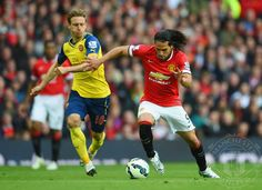 Radamel Falcao Garcia of Manchester United takes on Nacho Monreal of Arsenal during the Barclays Premier League match between Manchester United and Arsenal at Old Trafford on May 17, 2015 in Manchester, England.