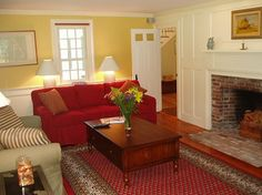 Red and yellow combo really works in this Truro living room.