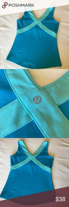 Lululemon Athletica Tank Top Fitness Blue 4/6 Lululemon Tank Top! The top is two beautiful shades of blue. Cross back and V-Neck. Excellent condition.  Size 6 lululemon athletica Tops Tank Tops
