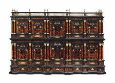 A SOUTH ITALIAN ORMOLU-MOUNTED TORTOISESHELL AND EBONY ARCHITECTURAL CABINET. NAPLES, LATE 17TH CENTURY. The interior with concealed drawers. 34 in. (86.5 cm.) high; 50 ¾ in. (129 cm.) wide; 20 ¾ in. (53 cm.) deep. -Christie's-
