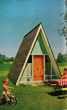 Vintage A-Frame playhouse.  Looks almost like the one my dad built for me with double dutch doors a front porch and electricity.