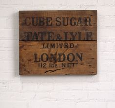 Early-1900s Tate & Lyle sugar crate lid wall hanging
