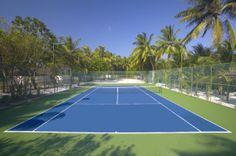 Tennis court at Lily Beach Resort & Spa Maldives,  for more details visit wwww.voyagewave.com