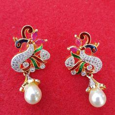 Peacock and pearl high quality american diamond earrings  #pearlearrings #peacock #mor #morni #indianjewelry #jewellery #sikhbride #pakistanibride #multicolor #jewellery #elegantjewelry #royal #americandiamond #the6ix #toronto #gold #silverjewelry #diamond #southasianbride #allthingsbridal #bridesmaids #jago #ruby #rubywoo http://gelinshop.com/ipost/1522707473261613874/?code=BUhvmEYl1My