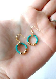 These dainty and tiny hoop earrings are made with turquoise color seed beads and swarovski stones. Necklace, bracelet and earrings are also sold as a set.* Handmade earrings * Turquoise and purple bugle beads * Guterman bugle beads and seed beads * Silver Wire Jewelry, Jewelry Crafts, Beaded Jewelry, Jewellery, Jewelry Ideas, Jewelry Bracelets, Diy Jewelry Inspiration, Pearl Necklaces, Geek Jewelry