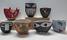 Pinch pots + African art... limiting color will help kids understand contrast