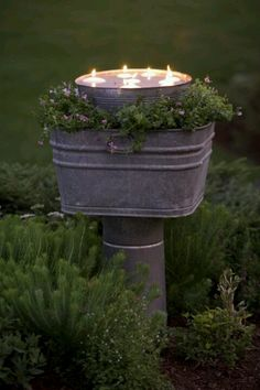 Outdoor lighting - floating tea lights, could also do plugged in lights in large jar upside down