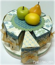 Paper cake with individual slices that you can fill with goodies. Template and tutorial.My friend made this for my 50th Birthday using this tutorial and template. It was one of the most exciting and memorable gifts ever