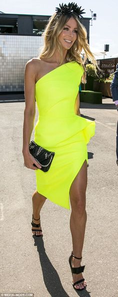 Turning heads! Jennifer Hawkins was electric in a fluorescent yellow frock with a peplum waist