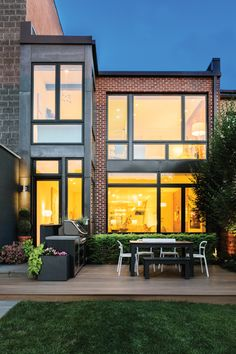 Viroc panels clad the small, two-story addition in back. Modern Architecture House, Modern House Design, Architecture Design, Sunroom Addition, Home Design Magazines, Industrial House, Modern Industrial, Cottage Style Homes, Building A Deck
