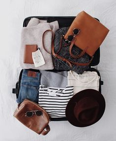 Stylish travel essentials. Travelling is the only thing that you can buy that will make you richer. Flatlay.