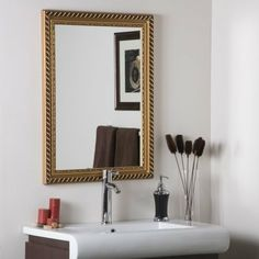 Decor Wonderland SSM68 Marina Gold Framed Wall Mirror by Decor Wonderland. $127.67. Finish: Gold - Glass: Etched. Material: Glass, Wood, Metal. SSM68 Features: -Material: Glass, wood and metal.-Crafted of thick, strong 3/16 glass and metal.-Double coated silver backing with seamed edges.-Hangs vertically and horizontally.-Great for bathrooms, living room or bedroom.-Wipe clean with a damp cloth.-Use only water or window-cleaner. Includes: -Mounting hardware in...