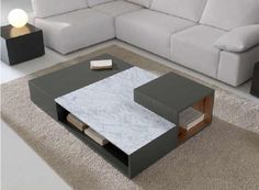Moderna mesa de centro en negro combinado con marmol